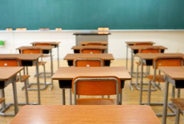 school desks and chalkboard
